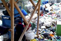 ressing plastic waste to a temporary landfill