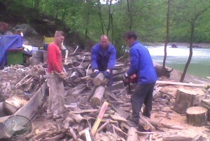 Wood cutting and sorting the temporary landfill